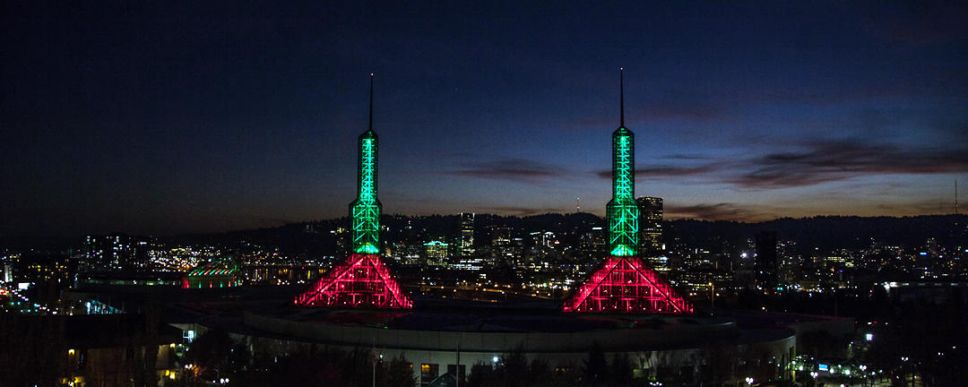 photo of OCC's spire and crescent lights in red and green