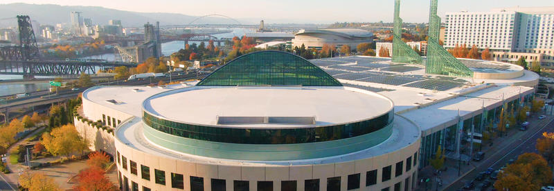 The Oregon Convention Center with the city of Portland in the background.