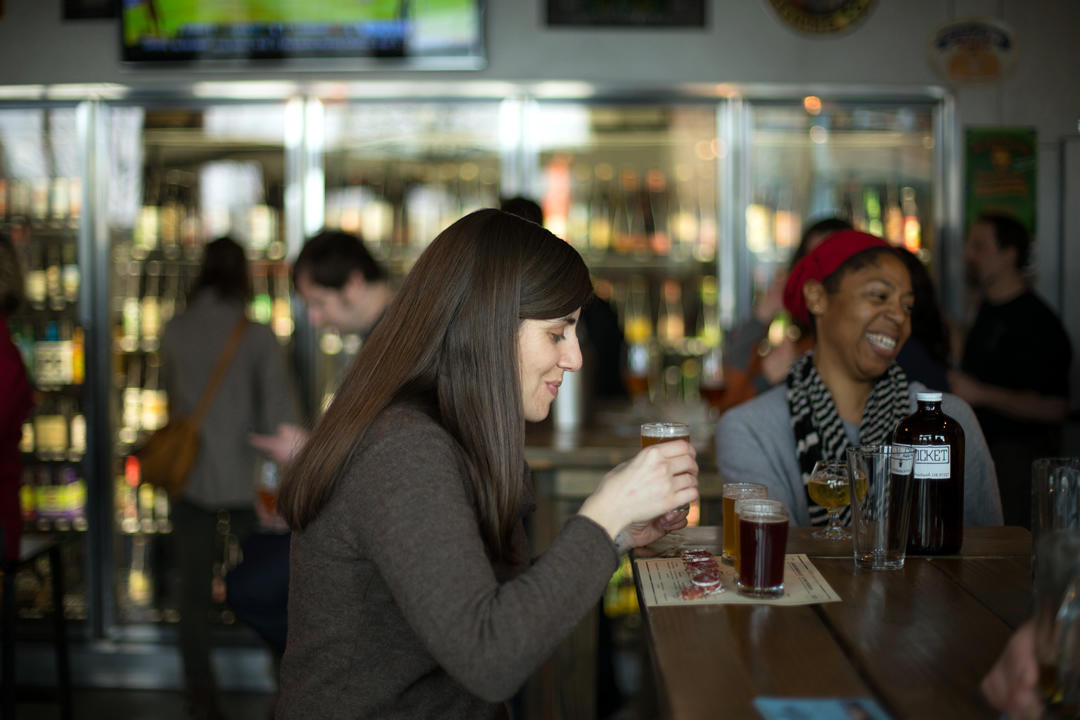 photo of person drinking a beer at a Portland brew pub