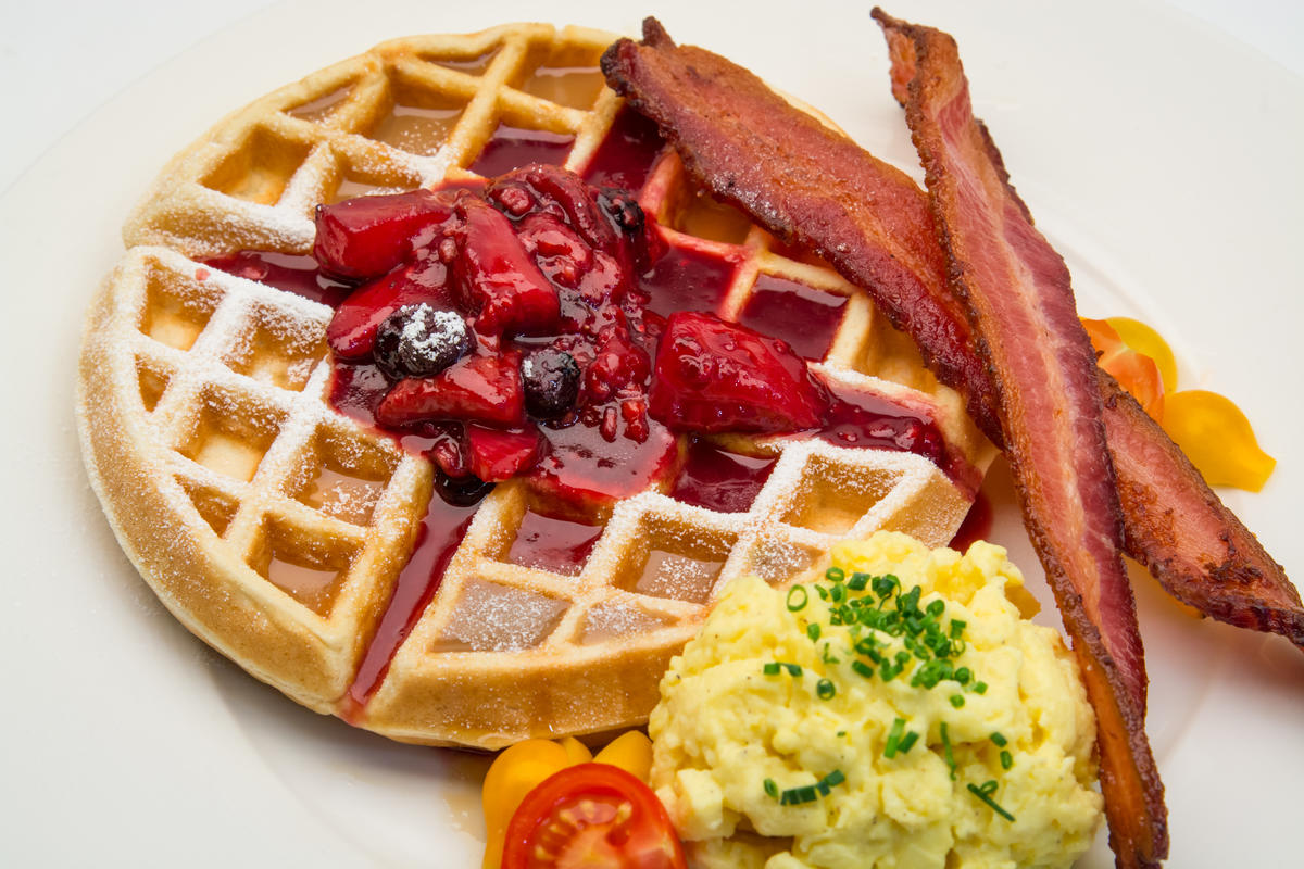 photo of belgium waffle with berry compote and bacon