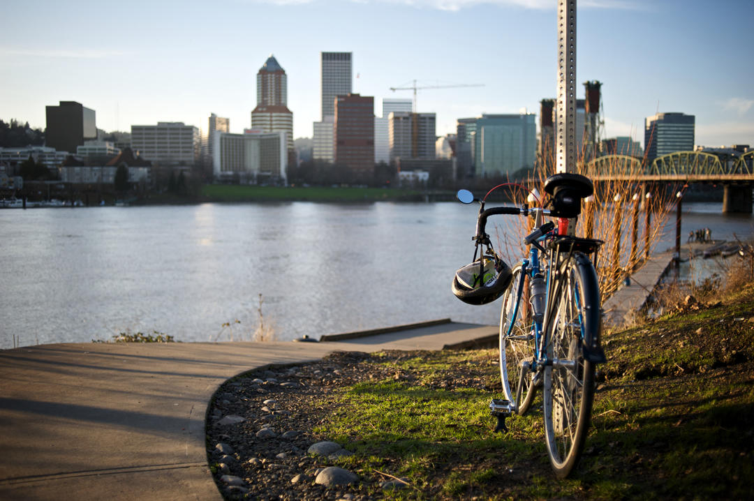 photo of a bike parked near the Willamette River in Portland