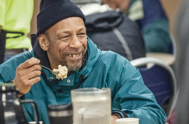 Man enjoys meal at the Portland Rescue Mission