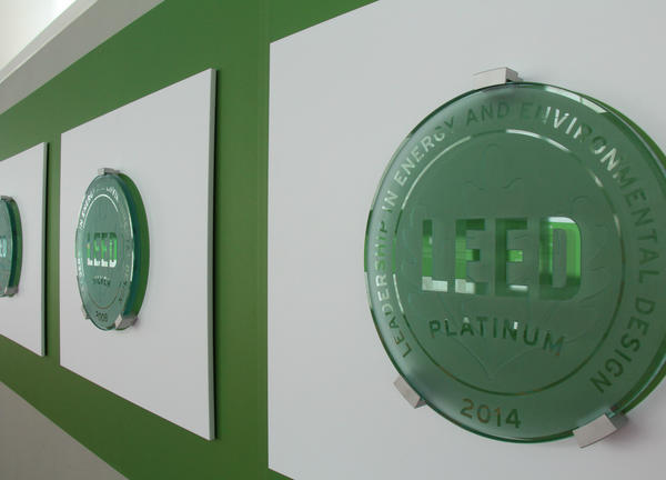 photo of LEED plaques on the green wall