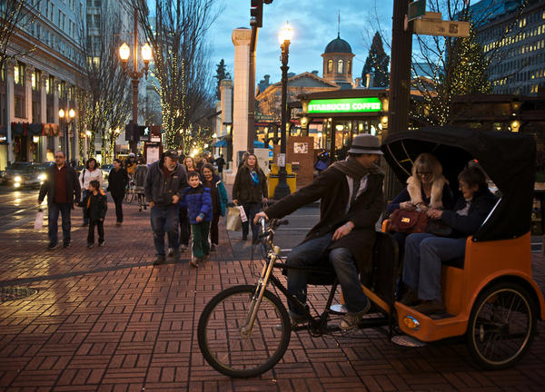 photo of holiday shoppers at night in Portland
